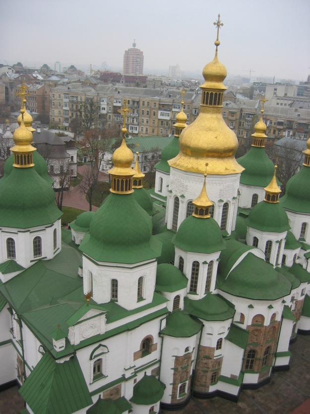 More golden cupolas against the otherwise grey city of Kiev.